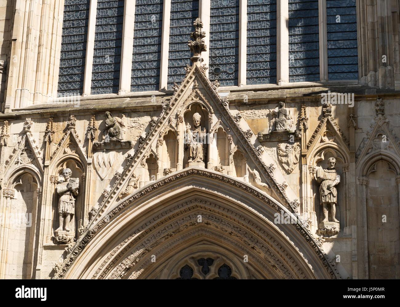 Religious statuary above west door of York MInster, York, North Yorkshire, England, UK - Stock Image