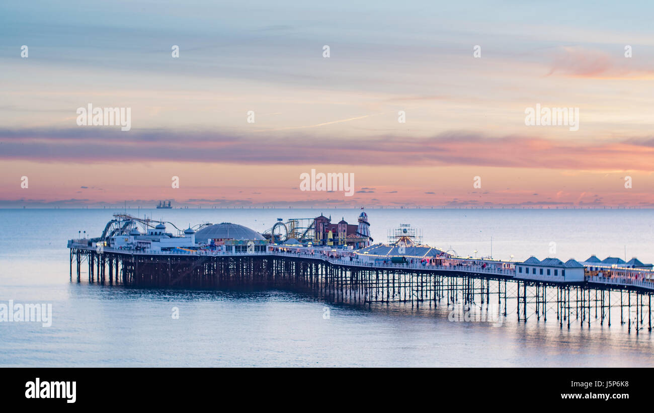 View of the Palace pier in Brighton at sunset - Stock Image
