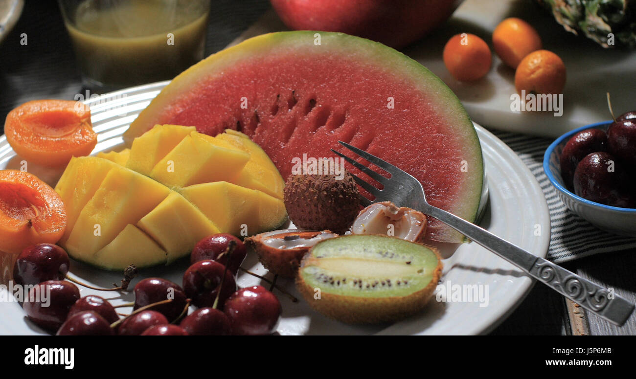 View of an assortment of fresh, healthy, organic fruits - Stock Image