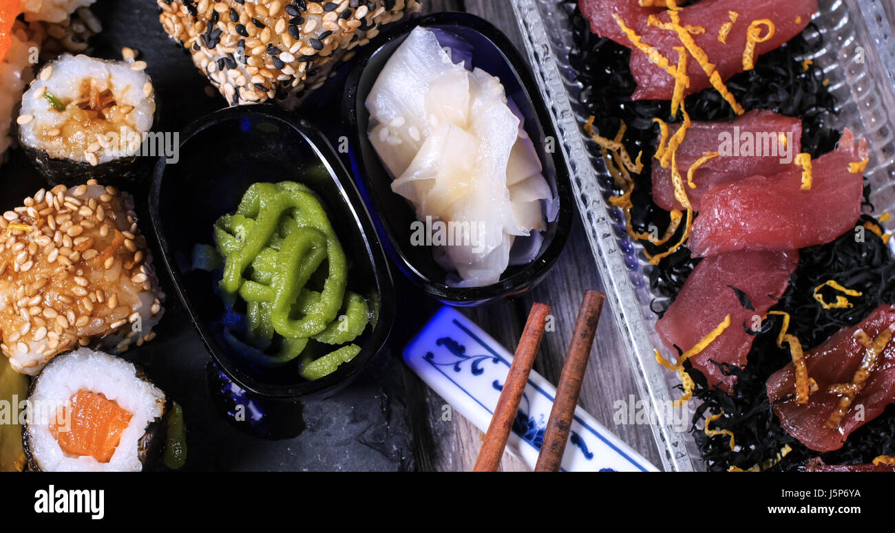 Close up view of an assortment of Japanese food: sushi, nigiri, sashimi, rolls - Stock Image