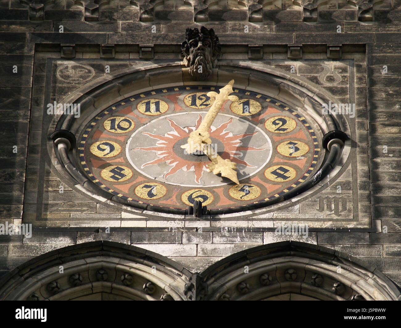 clock pointer time oblique dial churches masonry style of construction - Stock Image