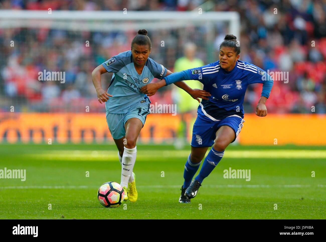 Nikita Parris of Manchester City (L) vies for the ball with Jessica Carter of Birmingham during the SSE Women's - Stock Image