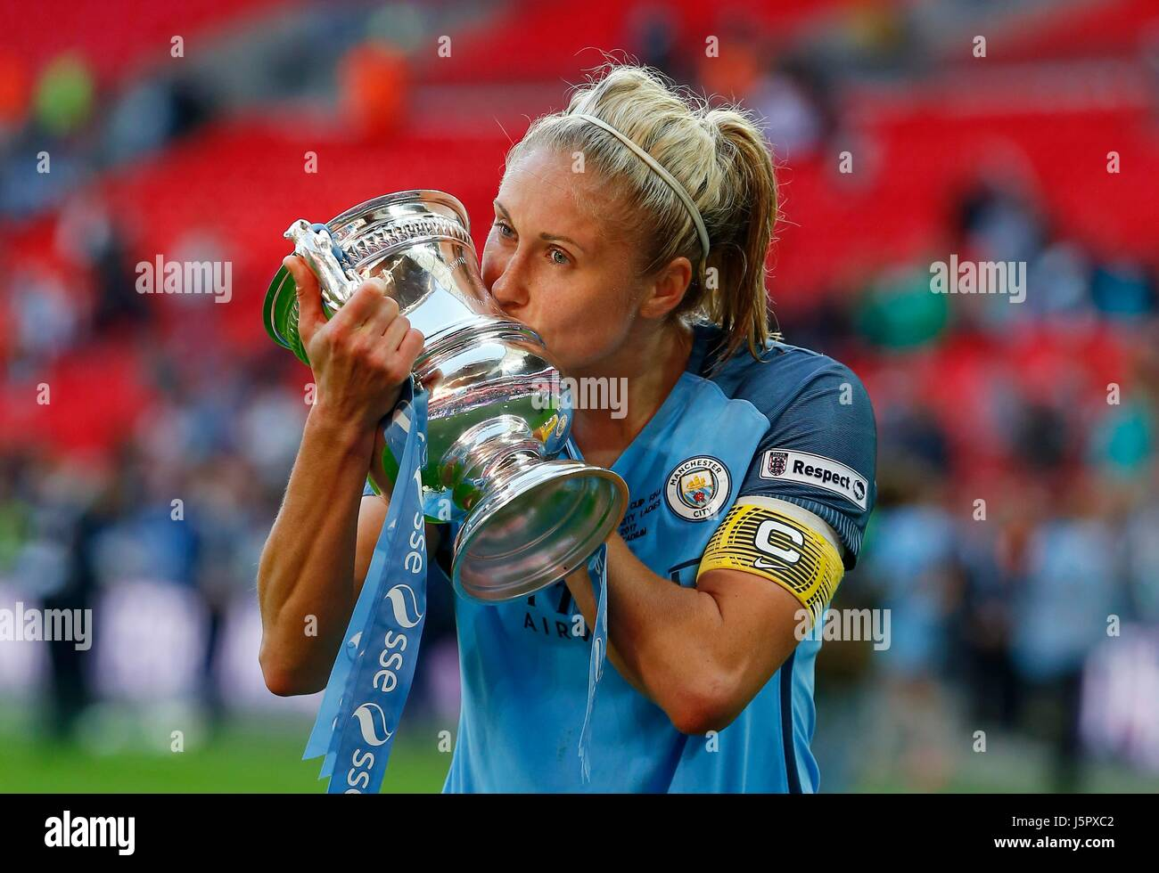 Manchester City captain Steph Houghton celebrates by kissing the cup during the SSE Women's FA Cup Final match - Stock Image