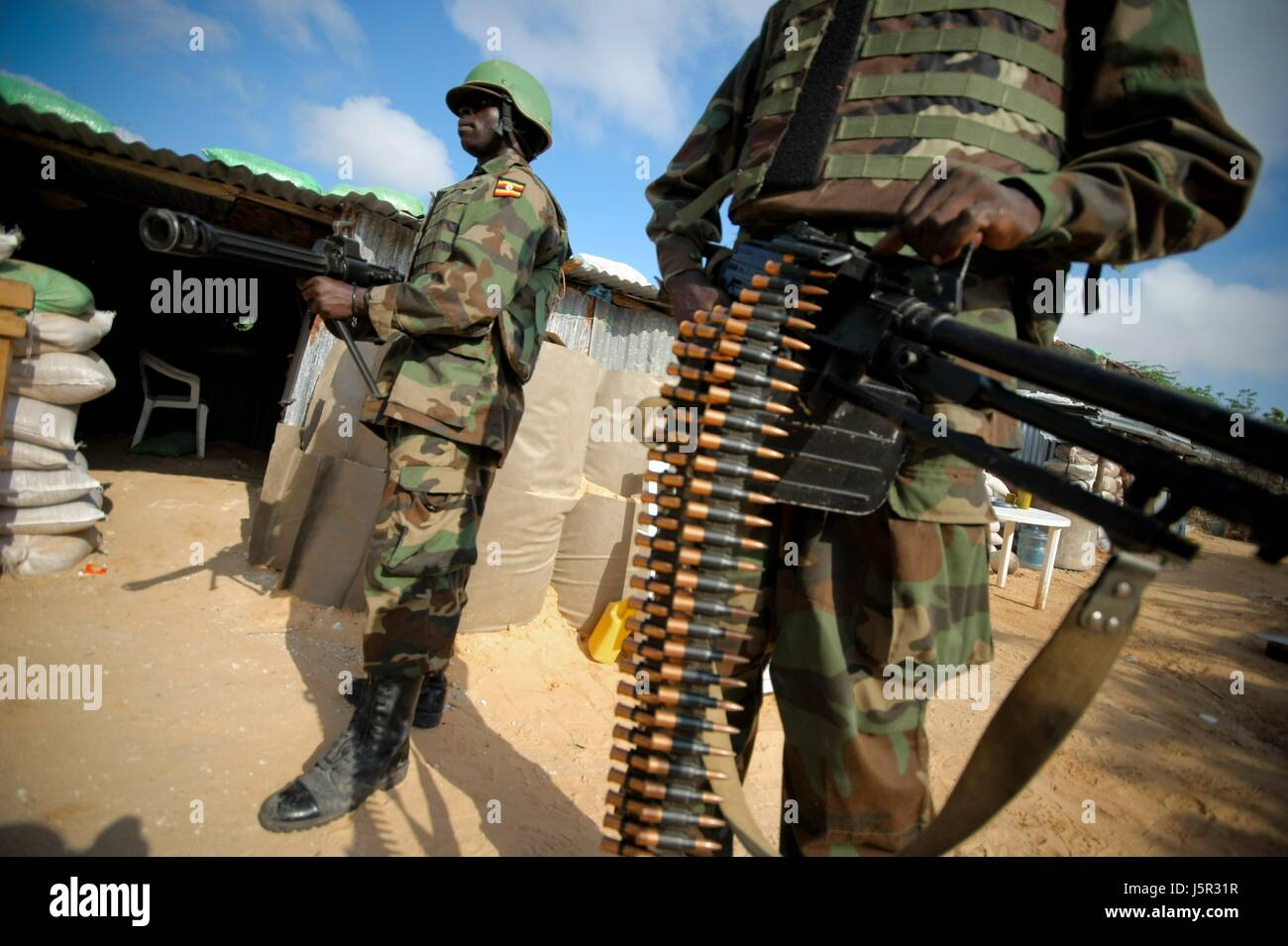 An African Union Mission in Somalia (AMISOM) Ugandan soldiers guard the frontline of the Yaaqshiid District, where - Stock Image