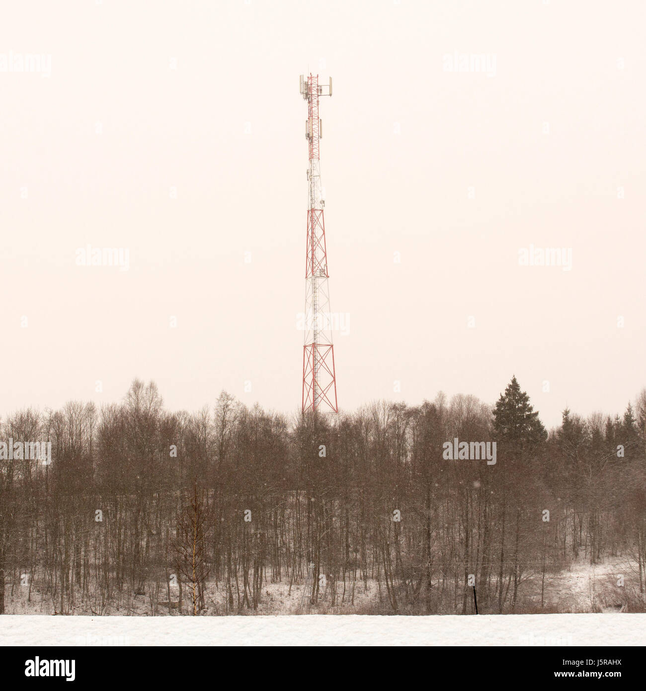 Telecommunication tower in winter - Stock Image