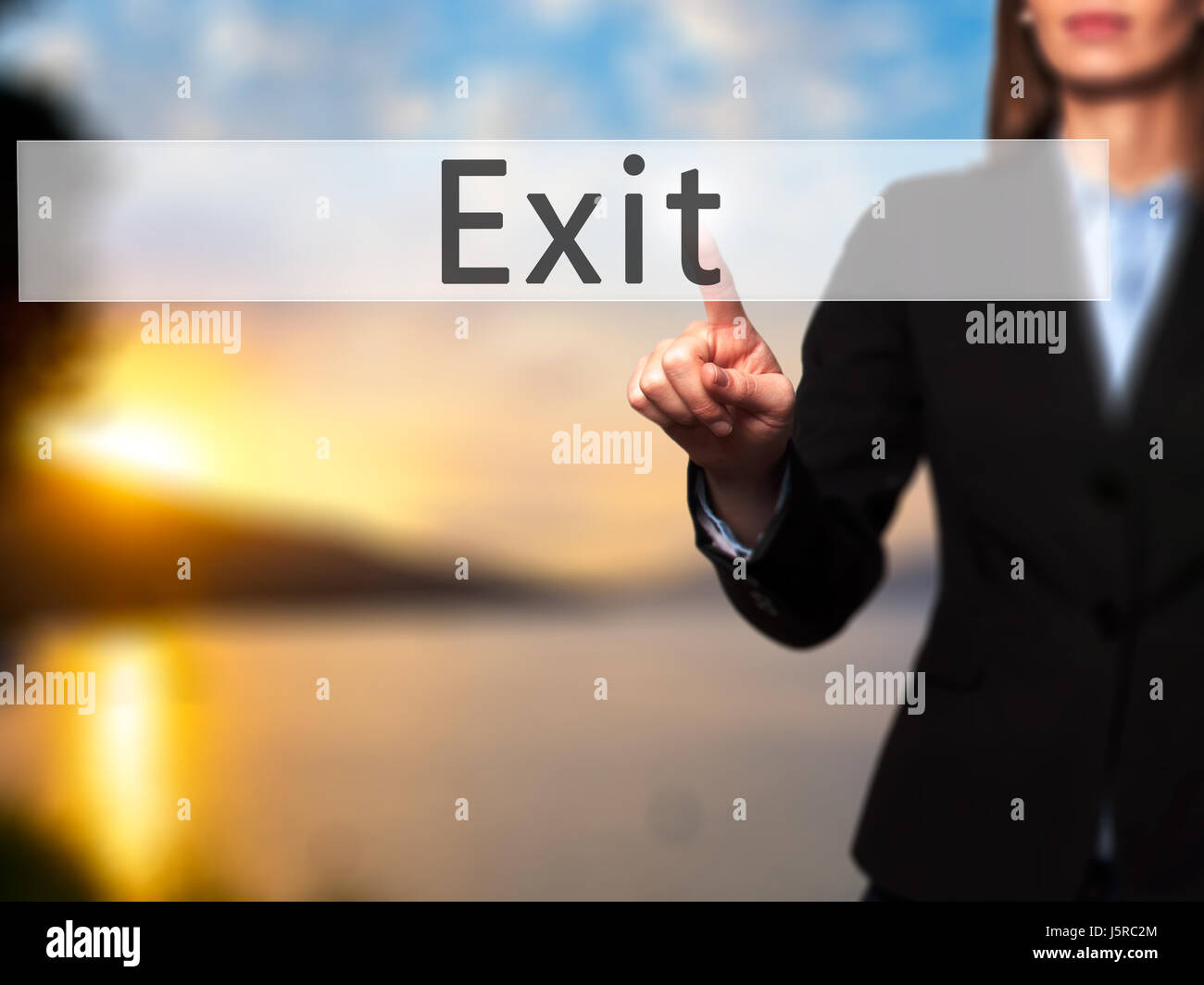 Exit - Businesswoman hand pressing button on touch screen interface. Business, technology, internet concept. Stock - Stock Image