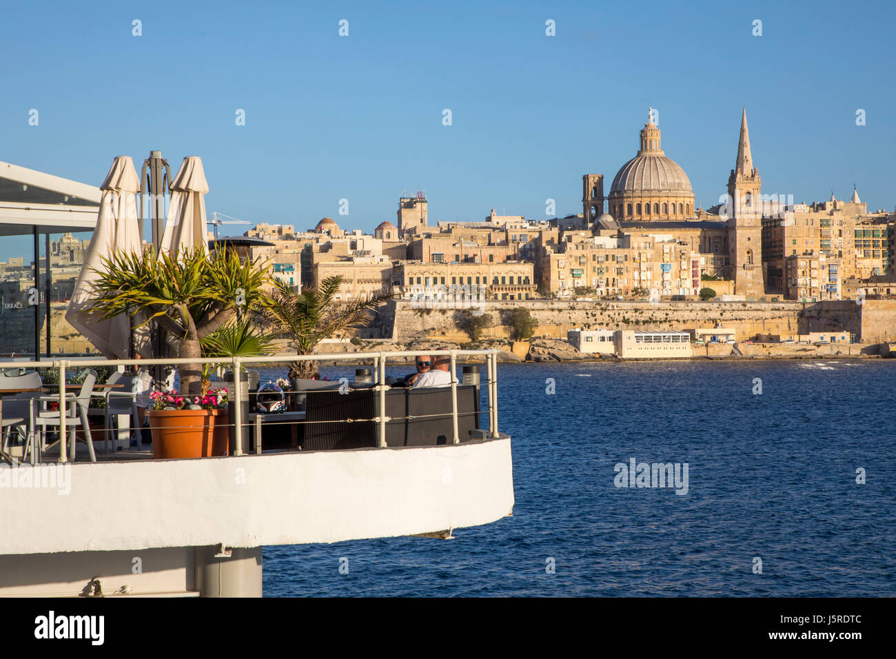 Skyline of Valetta, the capital of Malta, dome of the Carmelite church and steeple of St. Paul's Anglican Pro - Stock Image