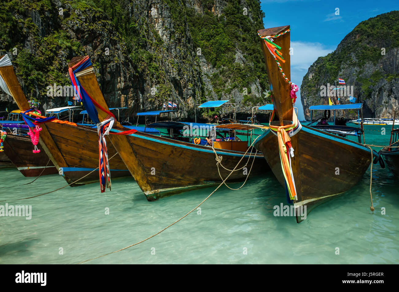 Boats at Phi Phi island in Thailand Stock Photo