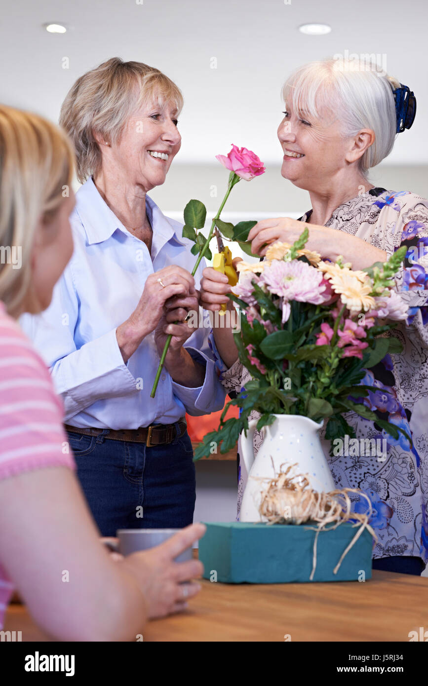 Women Meeting At Flower Arranging Class - Stock Image