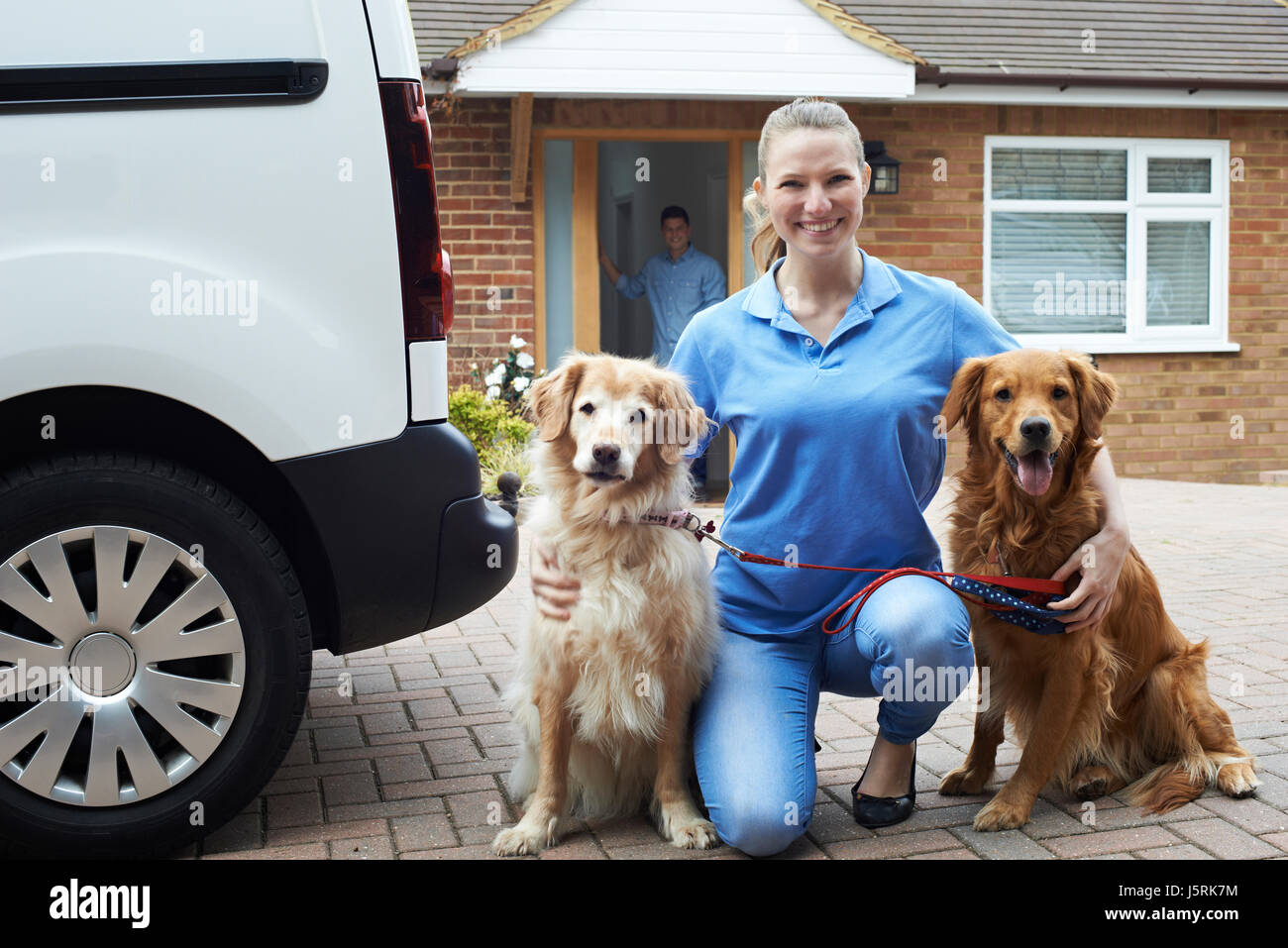 Portrait Of Woman Running Dog Walking Service - Stock Image