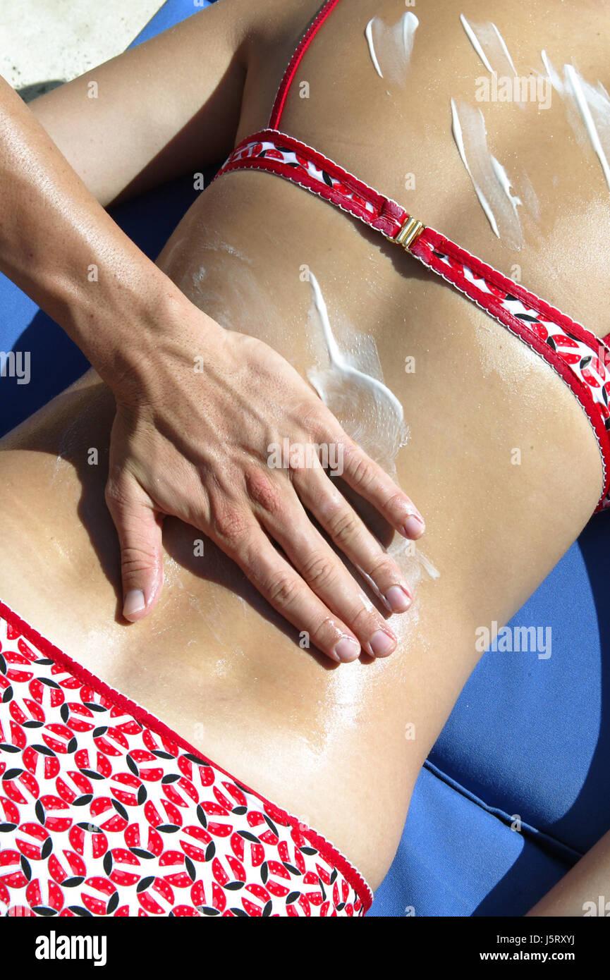 woman massage shelter from sun sun cream lotion shine shines bright lucent - Stock Image