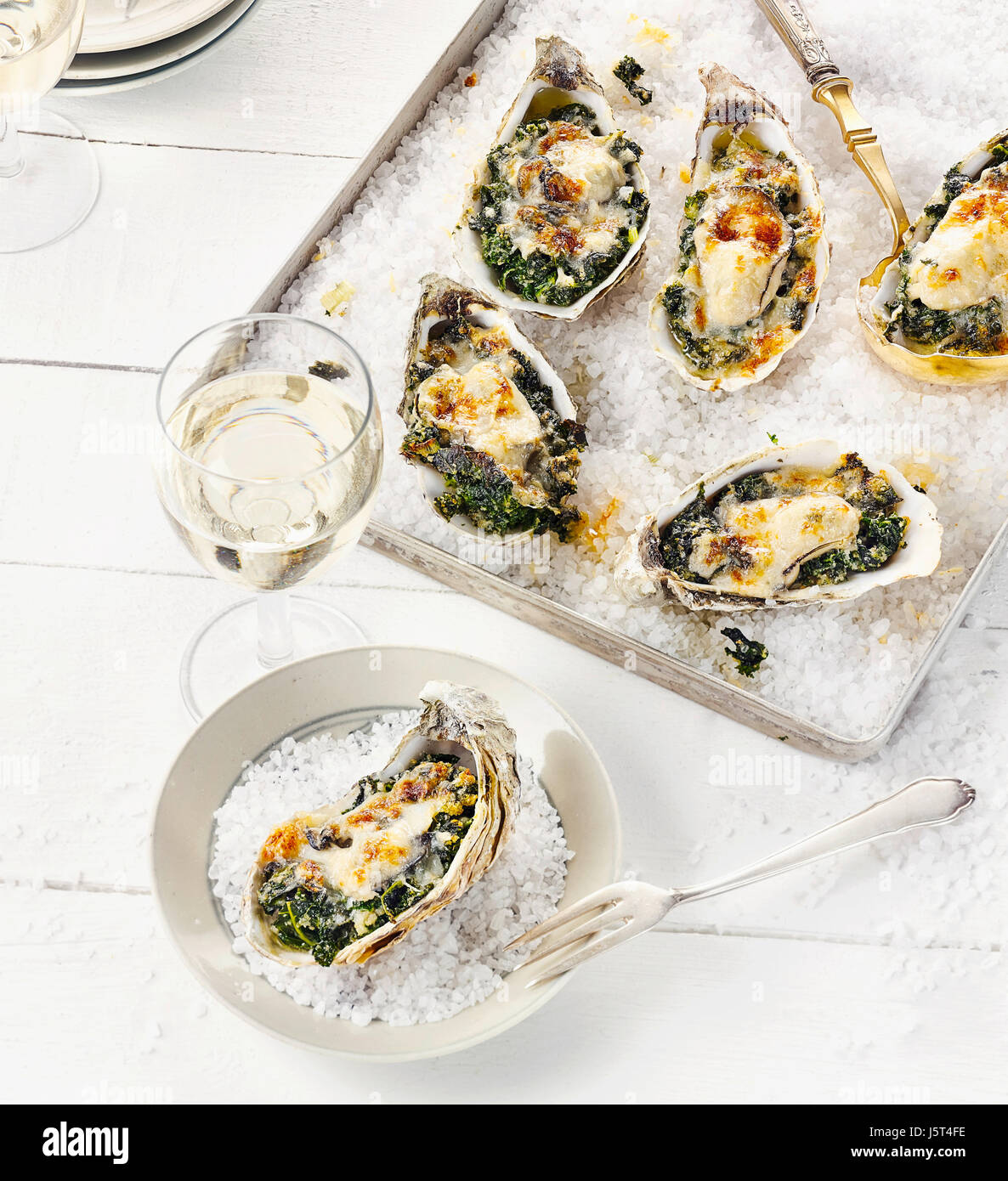 Gratinated oysters with kale filling - Stock Image