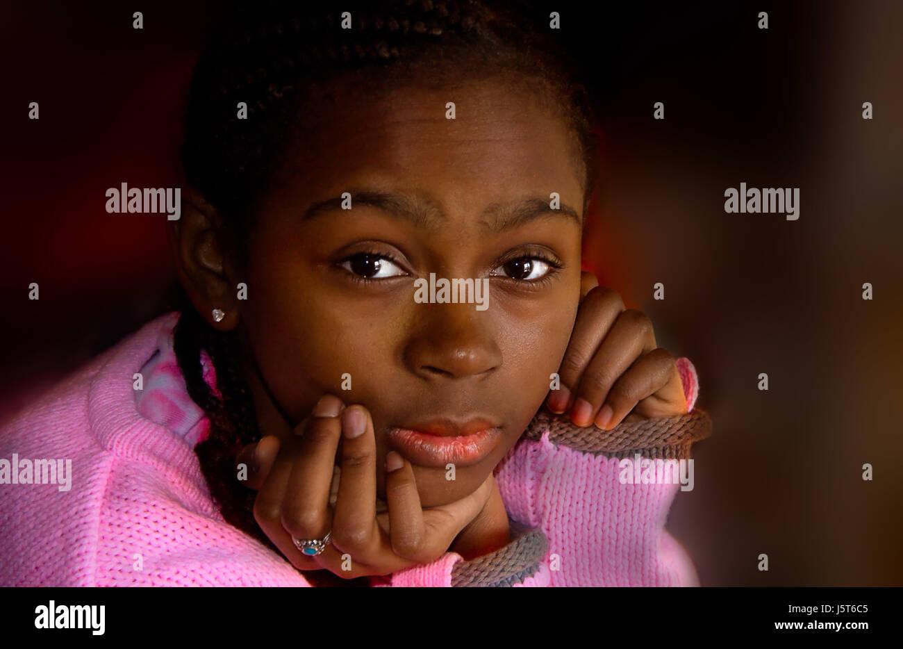 teen portrait meditate black blackness reflexion girl girls portrait black eyes - Stock Image