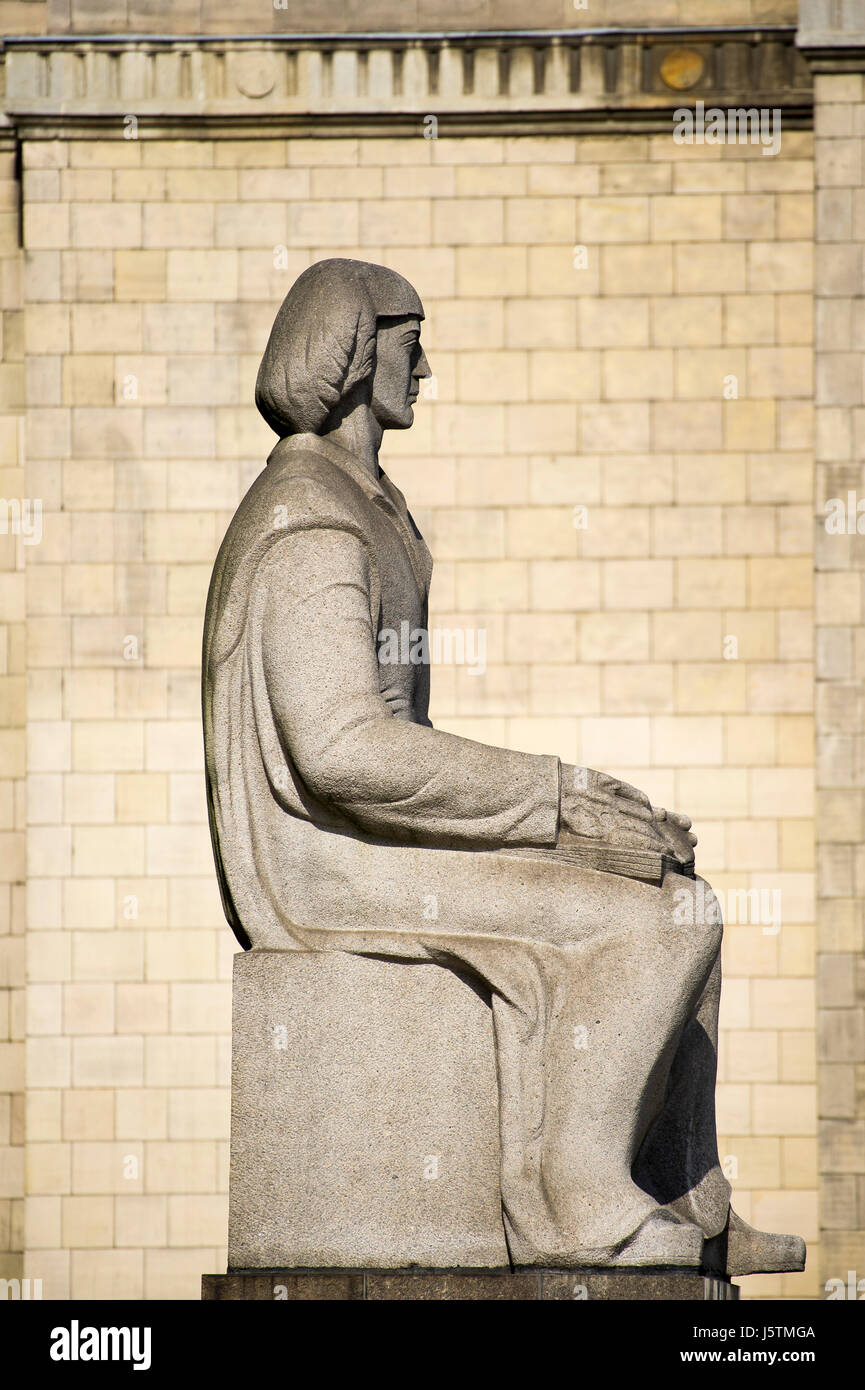 Statue of Nicolaus Copernicus at Palace of Culture and Science (Palac Kultury i Nauki PKiN) in Warsaw, Poland. Designed Stock Photo