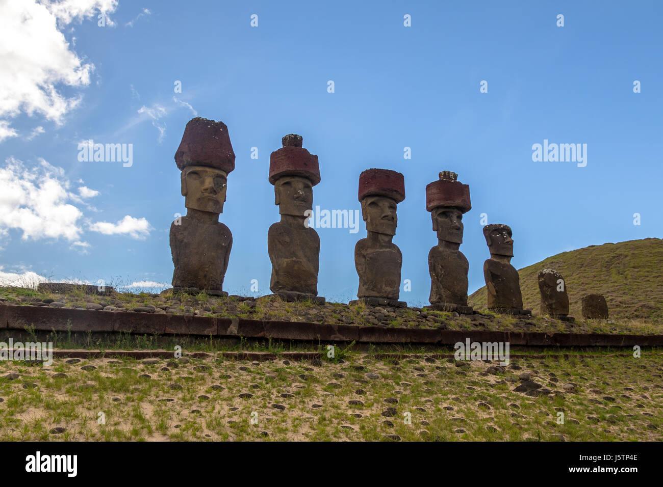Moai Statues of Ahu Nau Nau wearing topknots near Anakena Beach - Easter Island, Chile - Stock Image