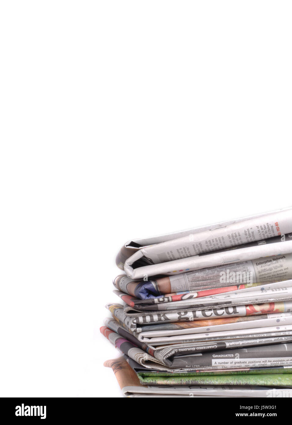 newspapers print publication newspaper journal objects isolated studio stack - Stock Image