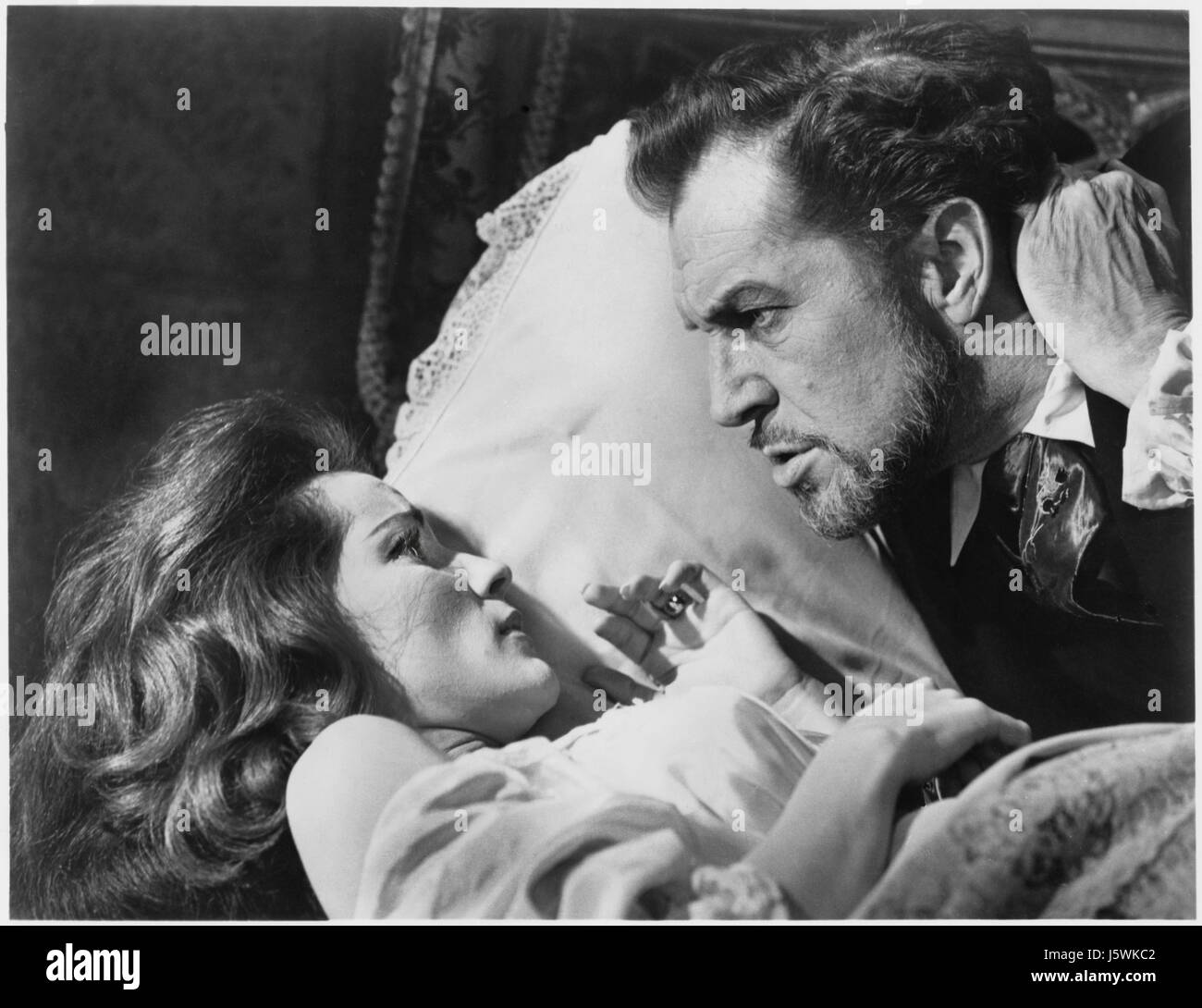 """Debra Paget, Vincent Price, on-set of the Film, """"The Haunted Palace"""", 1963 Stock Photo"""