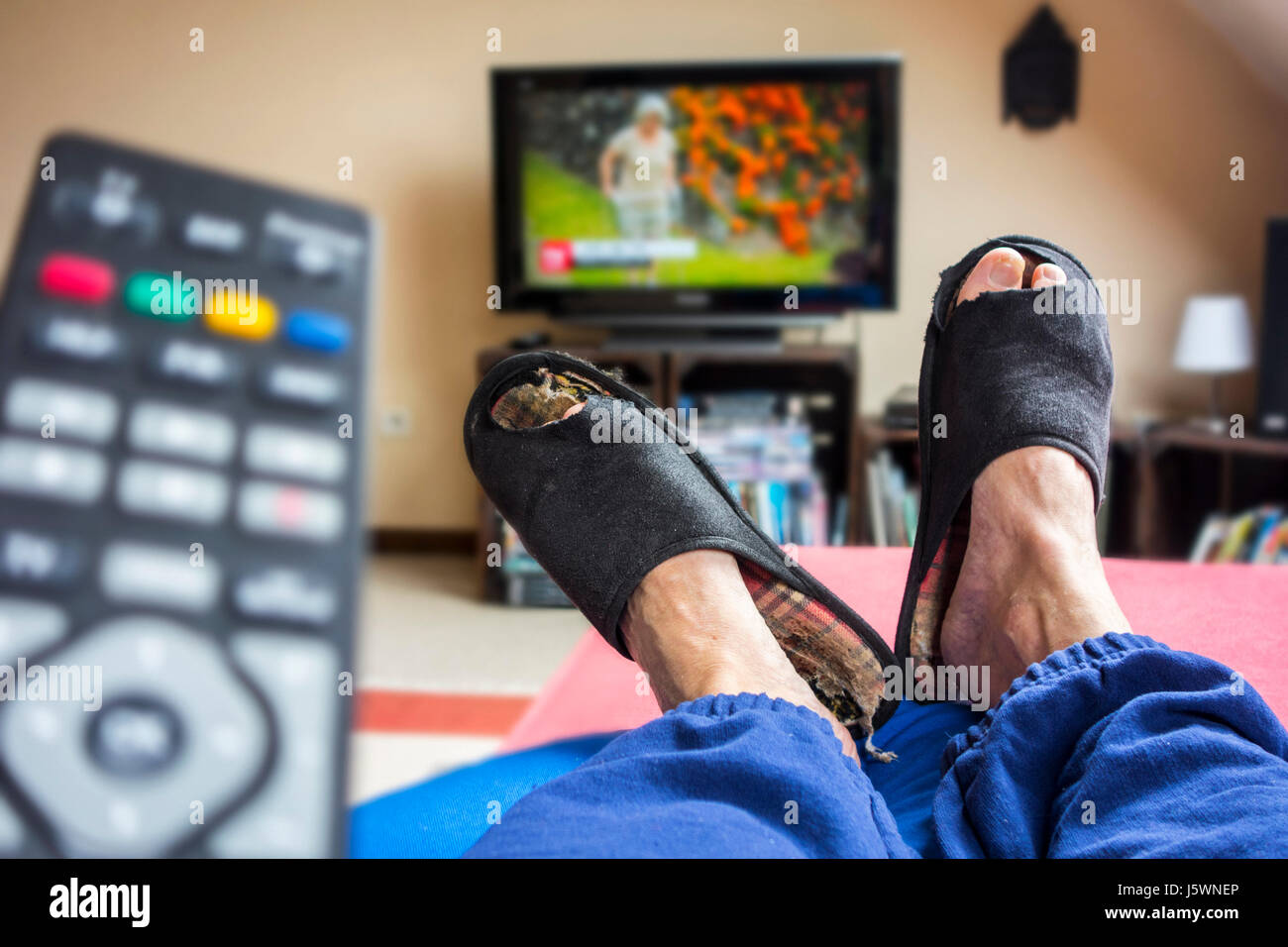 Remote control and couch potato, lazy man in comfy chair
