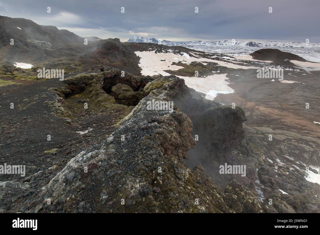 Fumarole at Leirhnjukur / Leirhnjúkur, lava field in the Krafla caldera in winter, Norðurland eystra / - Stock Image