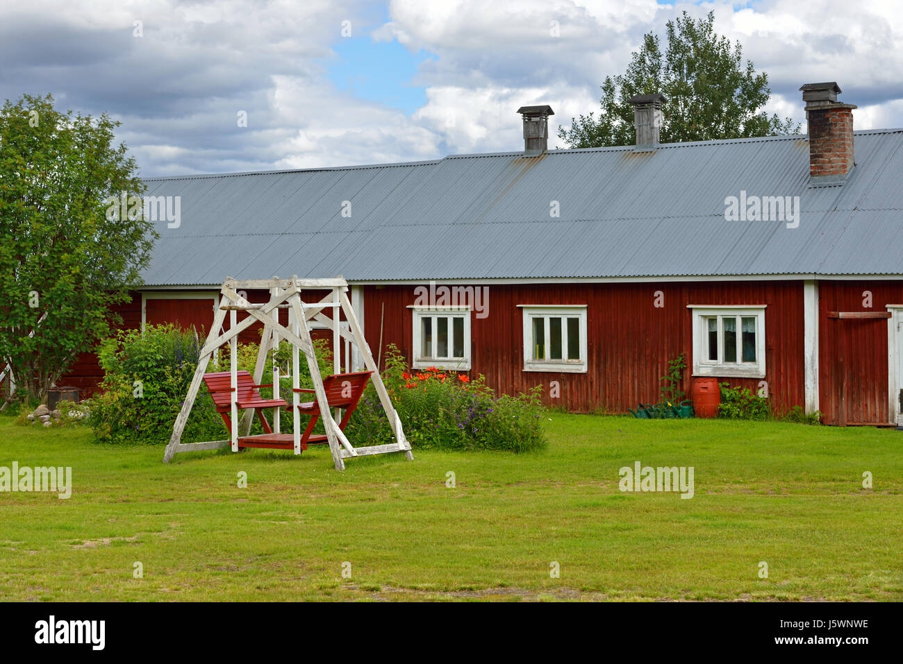 Traditional old rural house with swings. Finland, Lapland - Stock Image