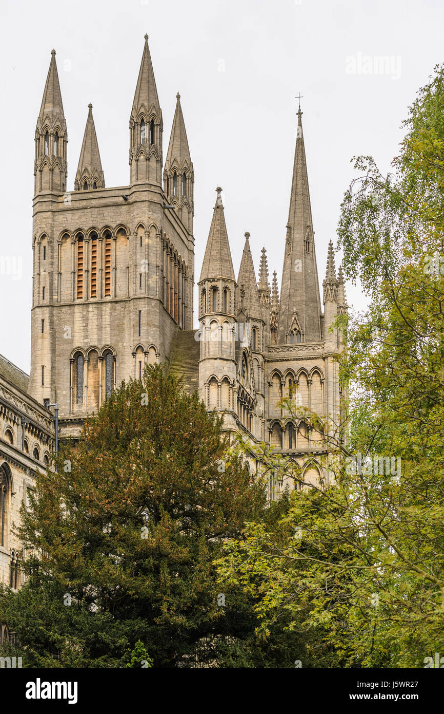 Towers and spires at the western end of the medieval christian cathedral at Peterborough, England. Stock Photo