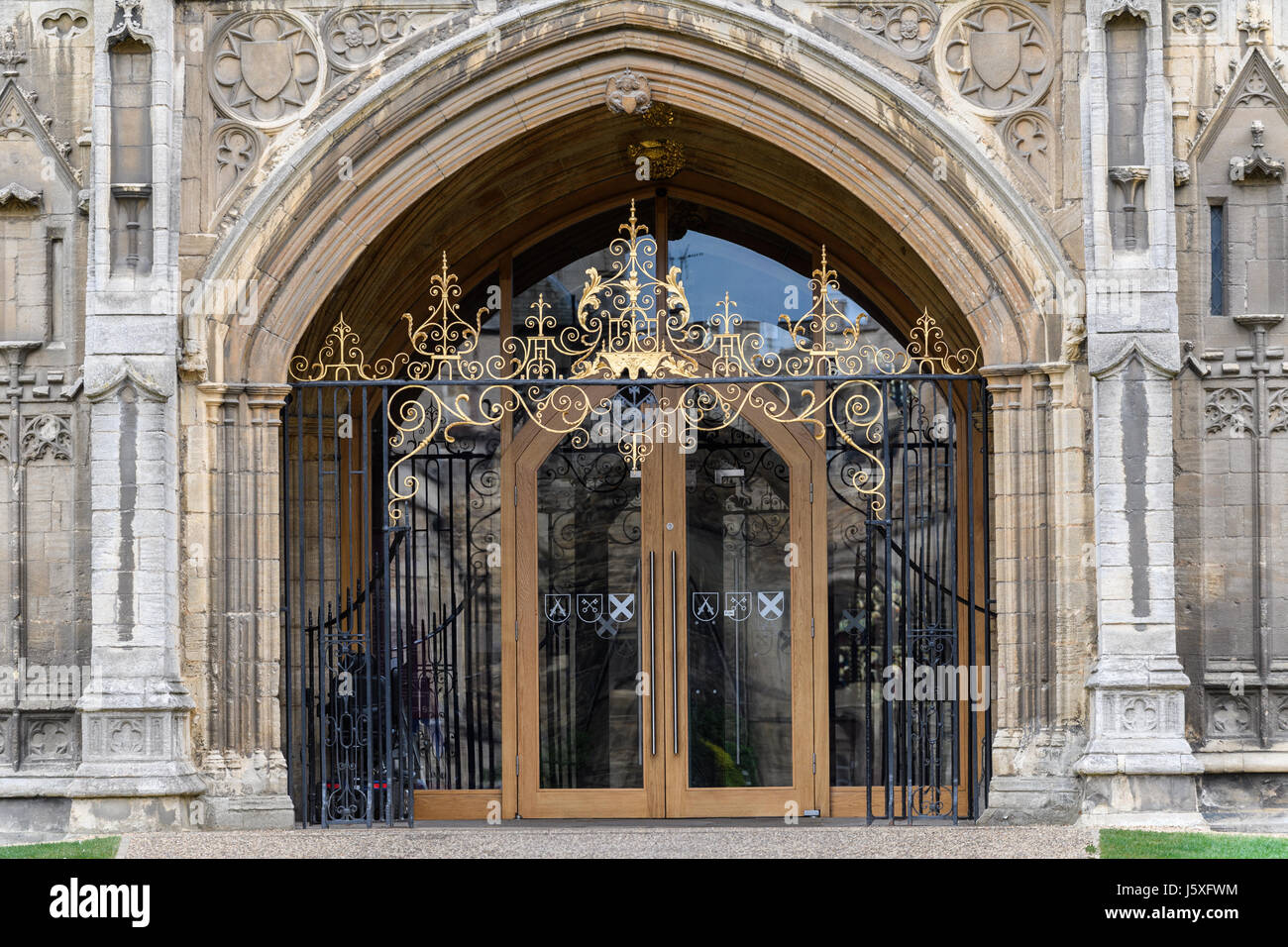 Entrance door at the west facade of the medieval christian cathedral at Peterborough, England. Stock Photo