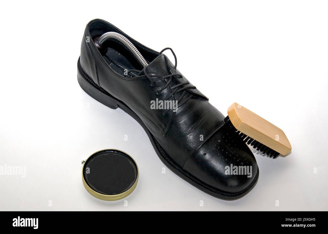 leather brush furbish clean shoepolish shoe black swarthy jetblack deep black Stock Photo
