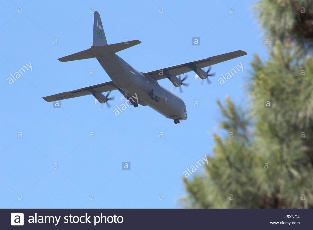 Air Force transport flying low - Stock Image