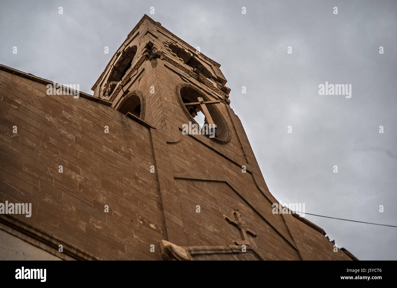 The Immaculate Conception Church tower stands destroyed after ISIS took over the Christian town of Qaraqosh in Iraq which was liberated from Islamic State in 2016. Stock Photo