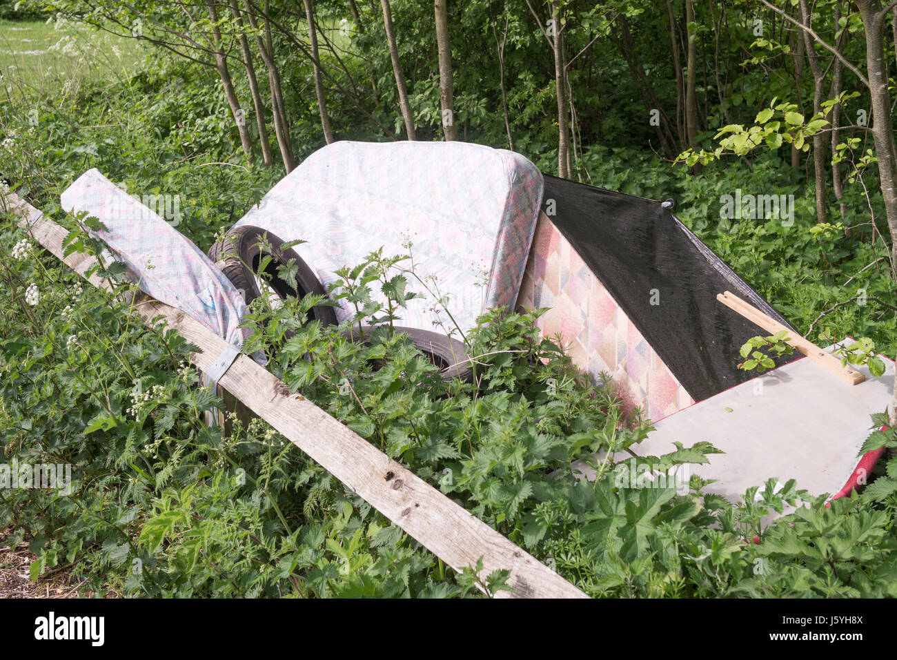 Illegal dumping or fly tipping at Beamish Woods car park, Co. Durham, England, UK - Stock Image