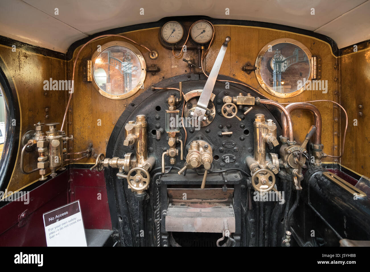 Inside the cab of Midland Railway 4-2-2 673 or Spinner in  the National Railway Museum York, England, UK - Stock Image