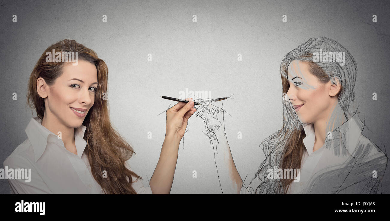 Create yourself, your future destiny, image, career concept. Attractive young woman drawing a picture, sketch of - Stock Image