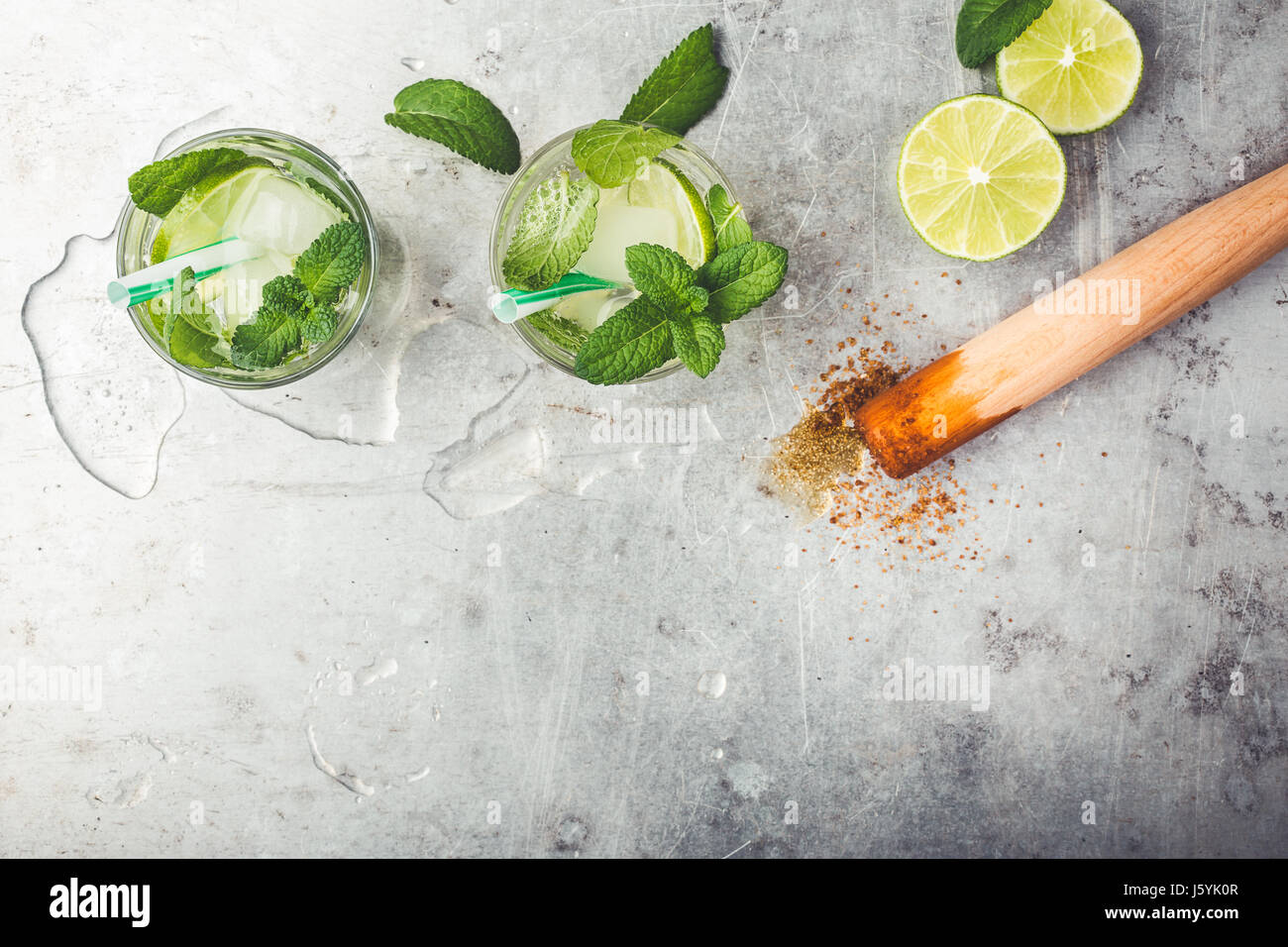 Mojito cocktail on light gray background with copy space for recipe or text viewed from above - Stock Image