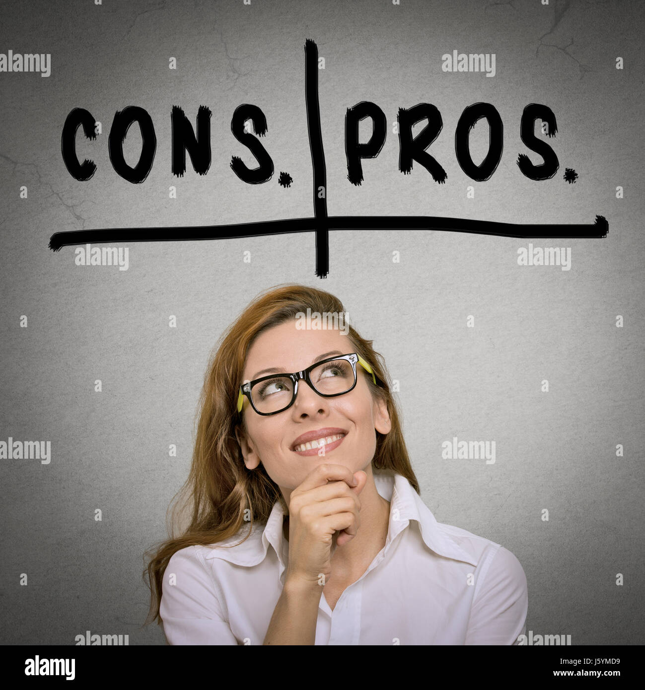 pros and cons, for and against argument concept. Thinking young business woman with glasses looking up isolated - Stock Image