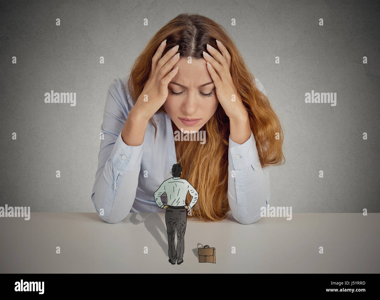 Desperate stressed business woman leaning on a desk small bossy executive man patronizing her. Negative human emotions - Stock Image