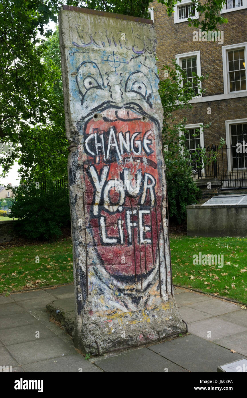 Graffiti covered concrete section of Berlin Wall displayed outside the Imperial War Museum in London. DETAILS IN - Stock Image