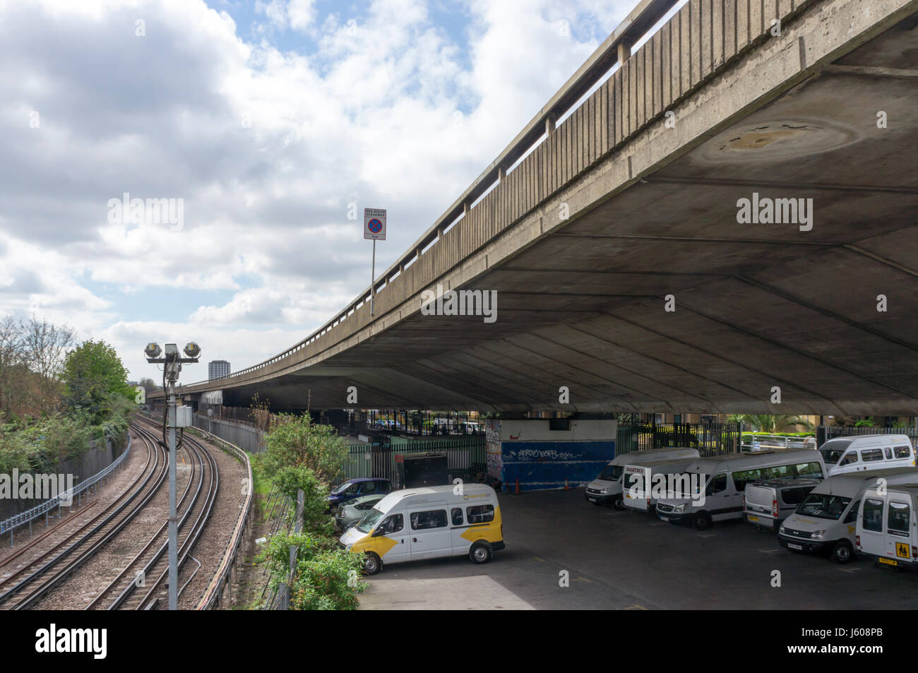 Section of the Westway near Ladbroke Grove, running next to an over ground section of the Hammersmith & City - Stock Image