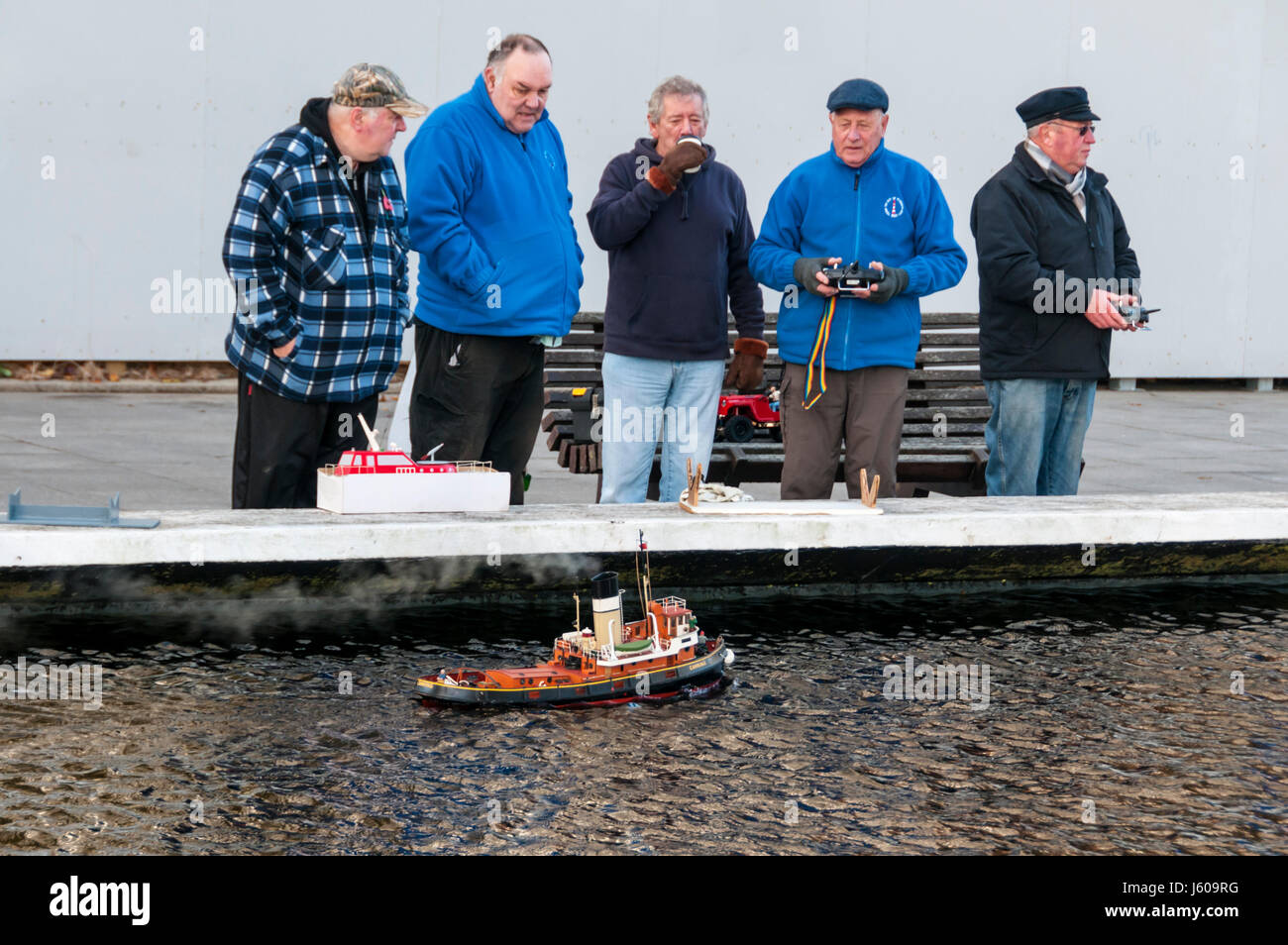 Men with radio controlled model boats in Plymouth. - Stock Image