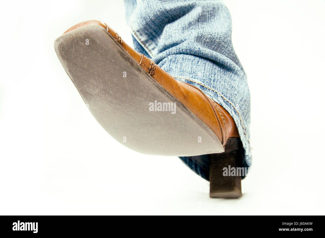 brown brownish brunette jeans trousers jean trousers foot shoe danger big large Stock Photo