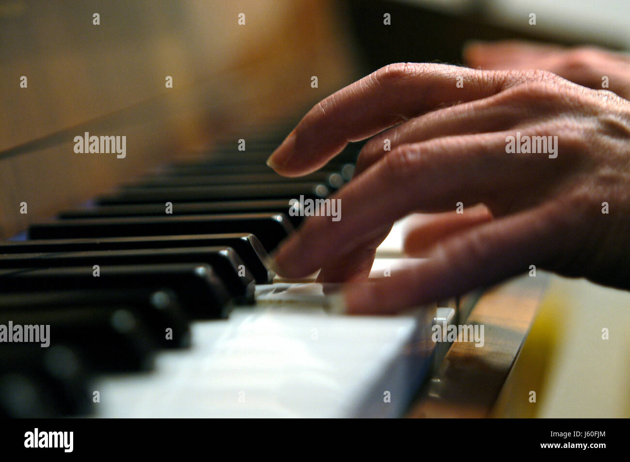 hand hands keyboard piano perform hand hands finger sound make music musical - Stock Image
