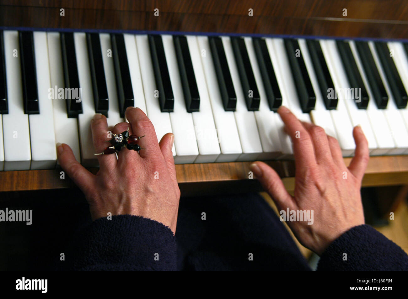 motion postponement moving movement hand hands keyboard ring piano hand hands - Stock Image