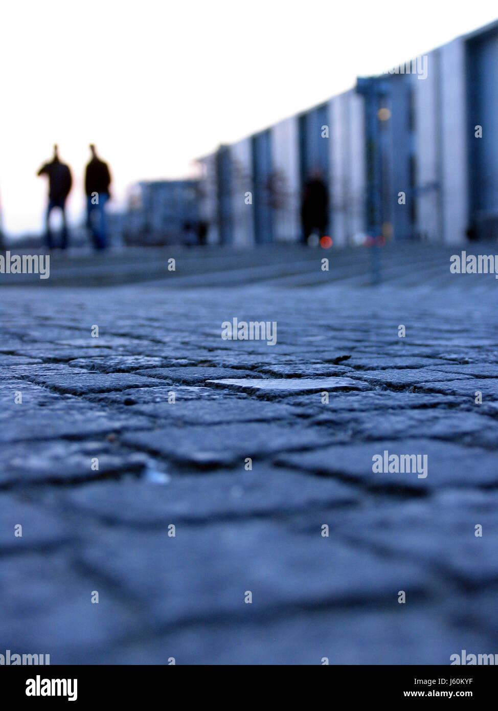 blue hour pedestrian cobblestone walk go for a walk street road blue city town - Stock Image