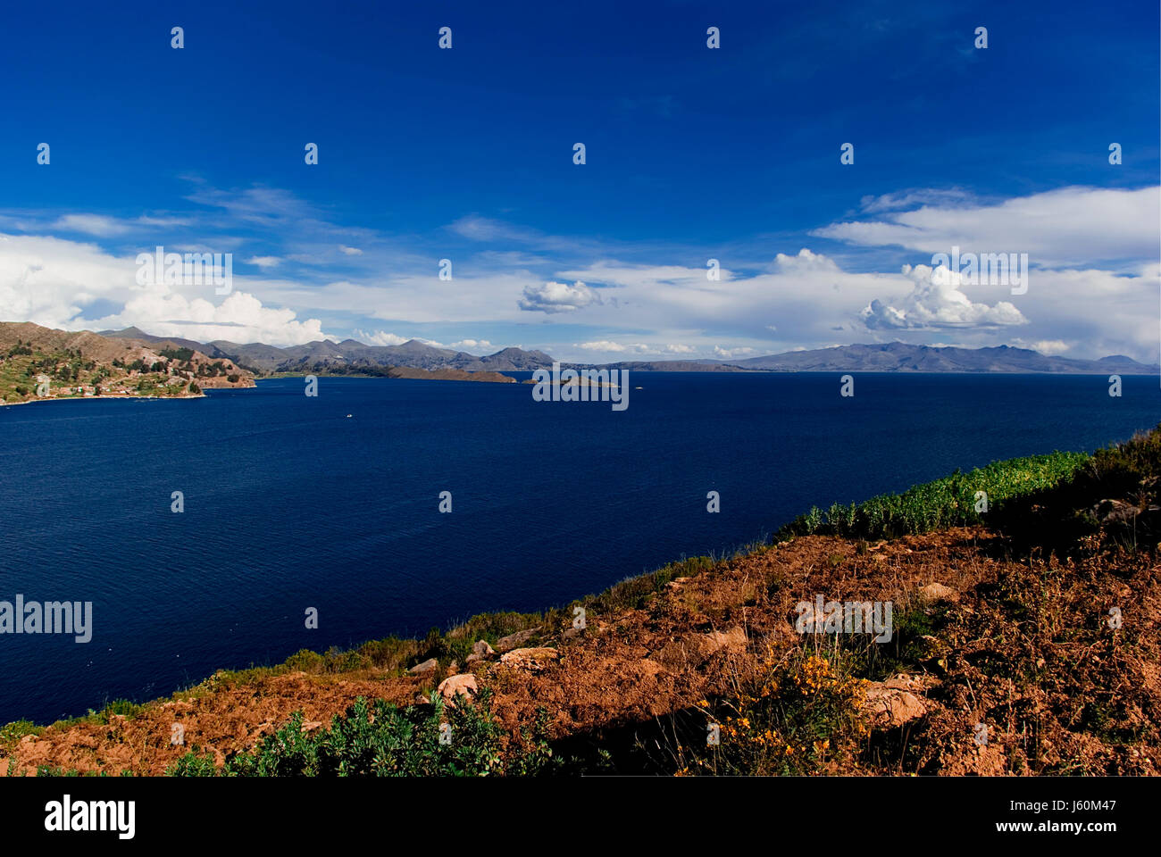 south america peru andes bolivia salt water sea ocean water blue mountains - Stock Image