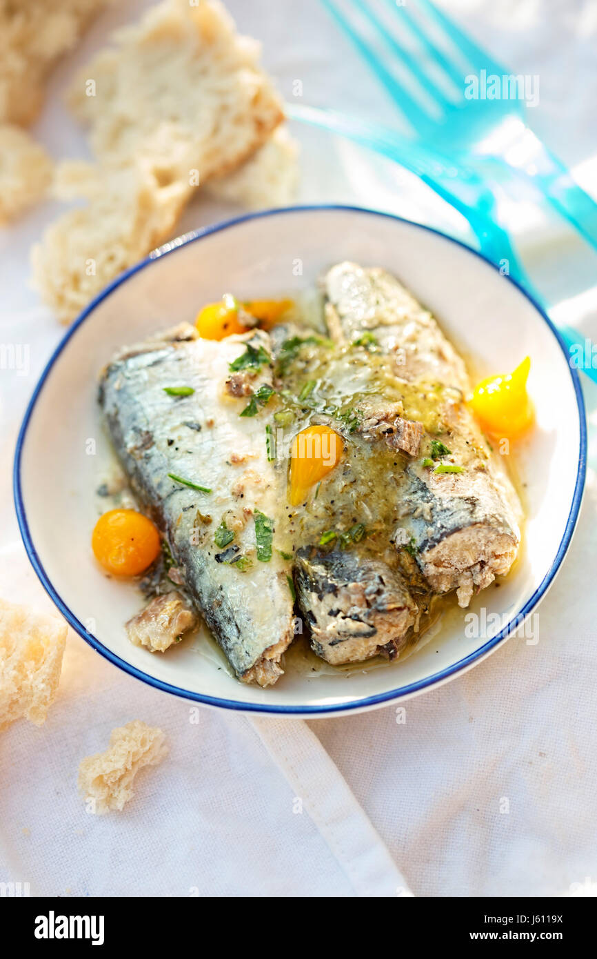 Sardines with garlic, lemon and roquito peppers - Stock Image