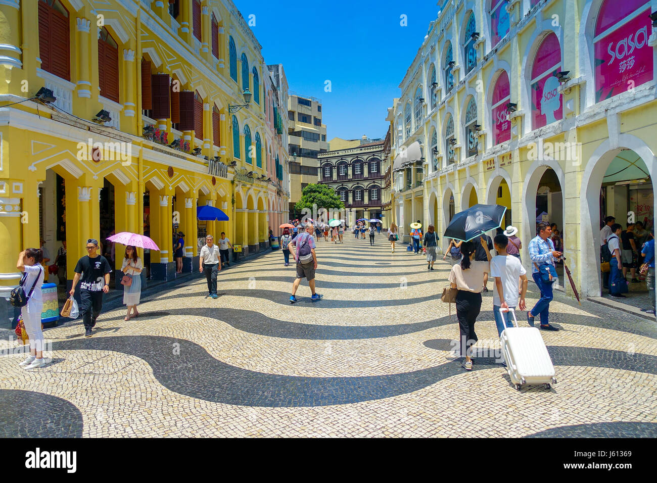 MACAU, CHINA- MAY 11, 2017: An unidentified people walking near of the Institute of Civic and Municipal Affairs - Stock Image