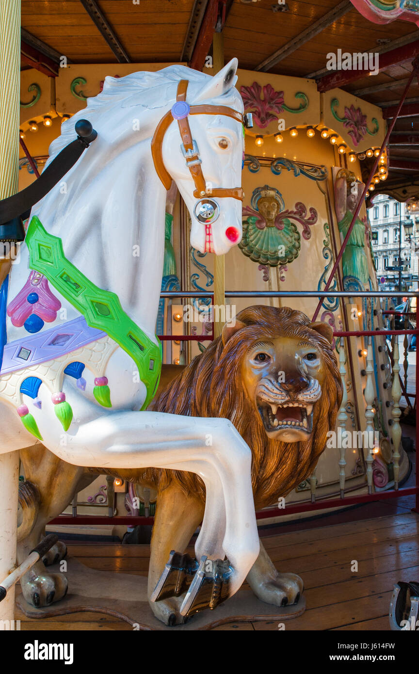 Old carousel with wooden horse and lion in Paris, France - Stock Image