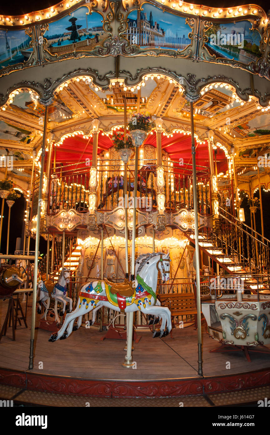 Old carousel with wooden horse in Paris, France - Stock Image