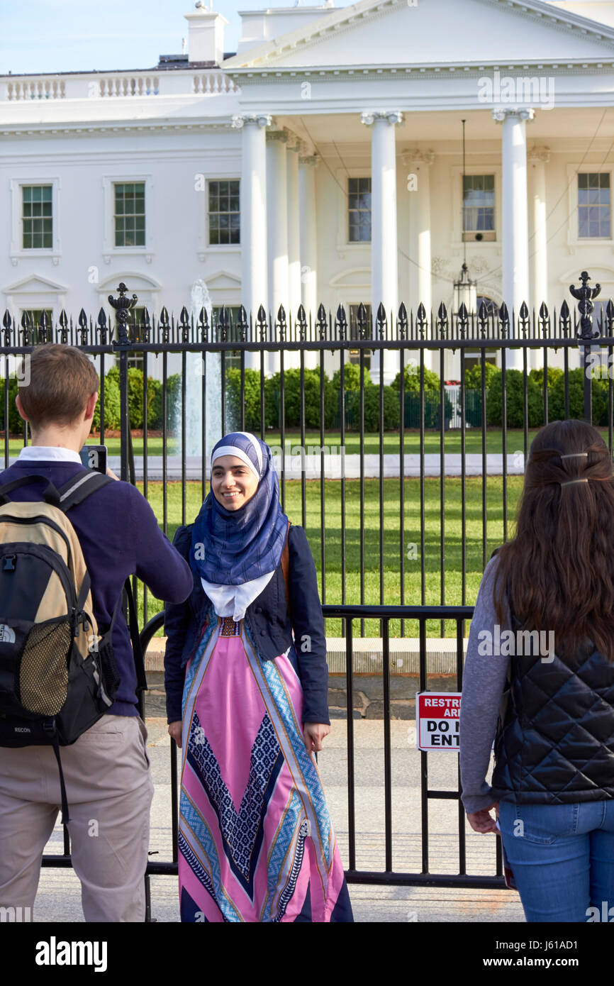 woman tourist wearing headscarf has photo taken outside the north facade from pennsylvania avenue the white house - Stock Image