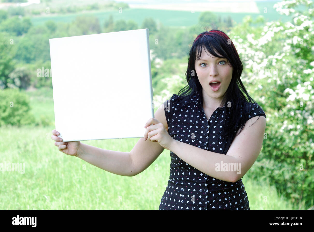 woman location shot wonder shield surprise publicity advertising surprised Stock Photo