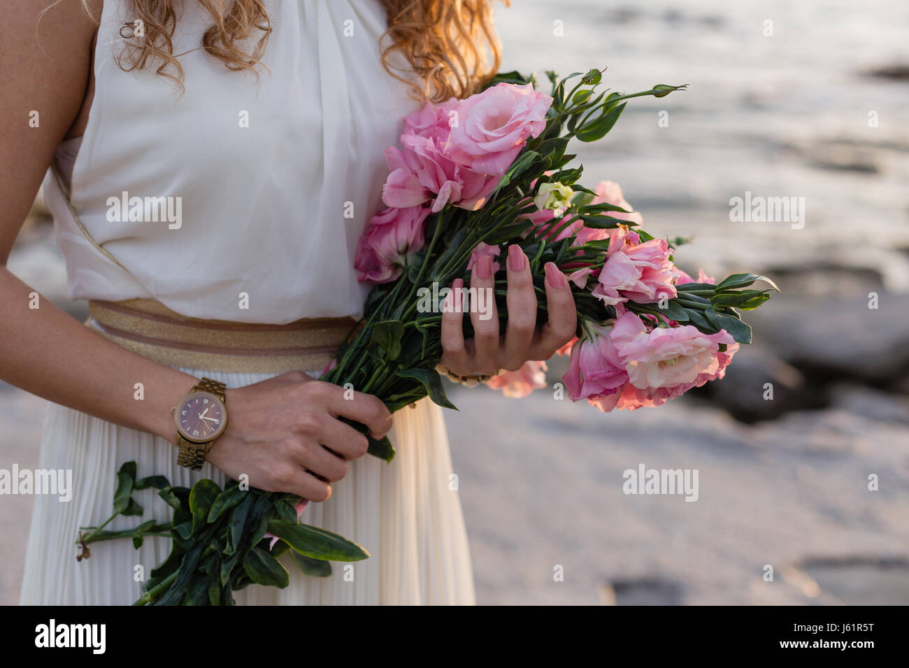 woman hands holding pink eustoma - Stock Image